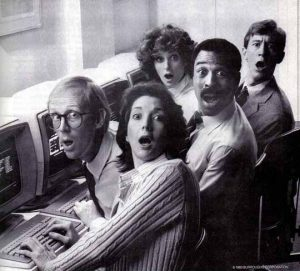 vintage photo of surprised people sitting in front of computers